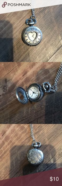 Adorable pocket watch necklace Pocket watch necklace that can open & close. Beautiful design on the back. Batteries are not included. Hot Topic Jewelry Necklaces