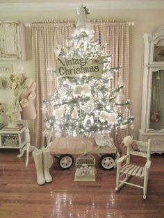 Pretty cottage Christmas tree.  Love the wagon ! (from Junk Chic Cottage)