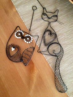 Wire wrapped cat and owl