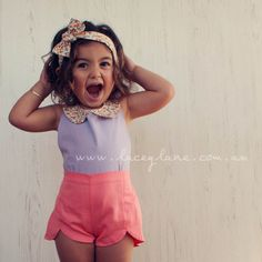 Vintage style Peter pan floral collar top. Love the low back and halter neck. Lacey Lane children's fashion for little girls. Paired with coral Maison petal shorts. High waisted. Headscarf styling. Fun photo shoot