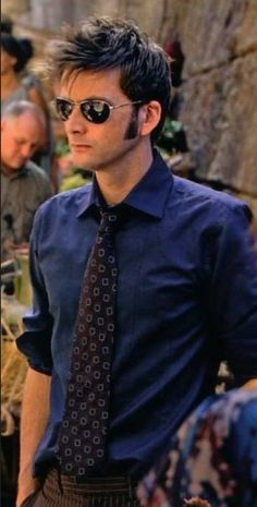 Shades. Shirt. Rolled up sleeves. Tie. Hair... David, for the love of all that's good and right, please stop being so perfect. It makes it hard to focus.