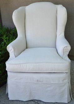 Drop cloth slipcover on a wing back chair