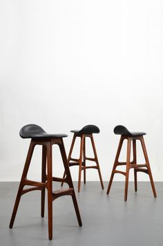 Erik Buch wood and leather stools.