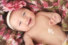 Two Month Old Baby Girl Big Smile With Pink Flower Massachusetts Newborn Photographer