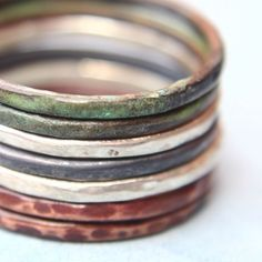 Seven Stacking Rings, hammered, two in polished sterling, one oxidized, two heat treated copper rings and  two copper rings with a verdigris patina by India y la Luna