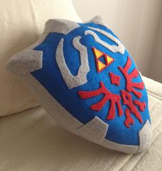 The Legend of Zelda Hylian Shield pillow.
