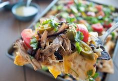 Delicious cheesy pulled pork nachos on a cookie sheet so that every bite is covered in cheese and smoothed with toppings - a perfect, quick weeknight meal! Pulled Pork Nachos, Veggie Snacks, Cooking Recipes, Healthy Recipes, Healthy Meals, Quick Weeknight Meals, Happy Foods, Mexican Food Recipes, Great Recipes