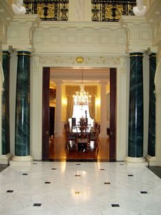 Roman Doric Plain Tapered Columns & Pilasters Faux Marble with Gold Trim Entry Hall Looking into Dining Room Photography: Barbara Heddinger Residential, Interior, Frederick Hart  www.columns.com