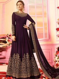 Bollywood diva drashti dhami style magenta embroidered anarkali suit online which is crafted from georgette fabric with exclusive embroidery and hand work. This stunning designer anarkali suit comes with santton bottom santoon inner and georgette dupatta.