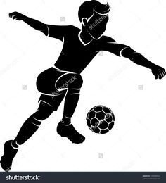 Silhouette of a boy kicking a soccer ball or football.