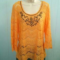 Beautiful Lacey Top Stunning tangerine color top with beaded neckline.  NWT.  Solid back,  lacey front.  Wide lacey sleeves. BKE Boutique  Tops Tunics