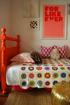 carved wood bed painted in a bright orange? yes please!