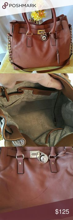 Michael Kors Hamilton Authentic Michael Kors Hamilton. When I purchased this bag is was told that it was in great shape, unfortunately it is not. I have posted pictures of the stains on the bag. Apart from the stains the bag is in good shape. Priced accordingly.   TV $200 Michael Kors Bags