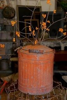 An old gas can with bittersweet..