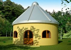 silo home with stucco finish and arched windows