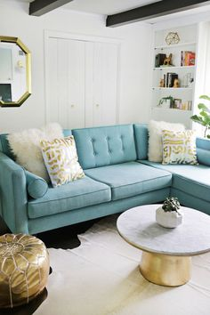 Love the turquoise sofa // Gold foil pillow DIY (click through for more!)