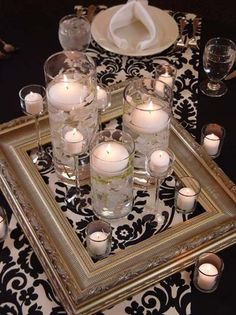 Love the frame idea for centerpieces: black and white wedding centerpiece ideas. Add coloured beads/stones around or in the candle holders to add colour or match your chosen theme. Wedding Centerpieces, Wedding Decorations, Centerpiece Ideas, Feather Centerpieces, Elegant Centerpieces, Diy Wedding, Wedding Reception, Wedding Ideas, Reception Ideas
