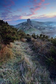 Corfe Castle The Castle is a fortification built by William the Conqueror during the eleventh century; and stands above the village with the same name in the county of Dorset, England. photo by Anthony Spencer