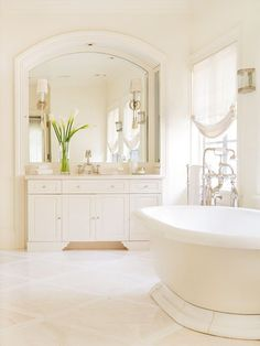 Dreamy White Ivory And Tile Floors Coordinate With Creamy Walls To Create A E Lovely In Its Simplicity