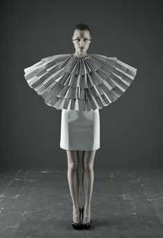 (Paper Fashion by Unknown) The use of paper here is fantastic. The starkness of the white emphasizes the winglike shape the paper creates.