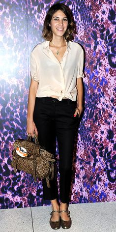Alexa Chung in Mulberry peach button-down, trousers and bag.