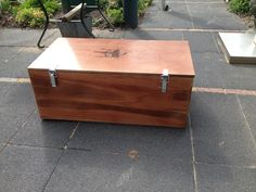 My own made box to store tools for my tablesaw. Made out of plywood with a spray laquer finish.