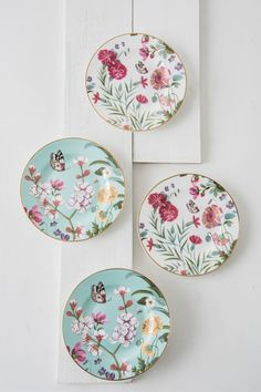 Persia Garden Plates ~ Set of four delicate katori's, featuring hand drawn flower motifs and an outer band of green ferns and flowers set atop a soft aquamarine base.