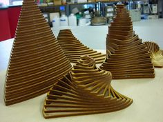 Laser cut wood assembled, originally uploaded by techshopdurham.  These are really cool. They are simple shapes that are simply arranged to make a complex assembly.