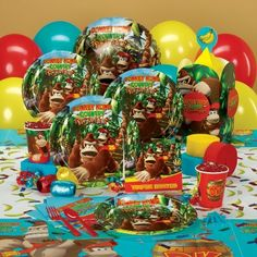 Donkey Kong Birthday Party Theme  EXCLUSIVE  Your Deluxe Pack for 8 includes (8) invitations, dinner plates, cups, forks, spoons, activity placemats, (20) napkins, tablecover, centerpiece, foil balloon, 18 latex balloons (3 colors), crepe paper rolls (3 colors), curling ribbon (3 colors), confetti and cake candles.
