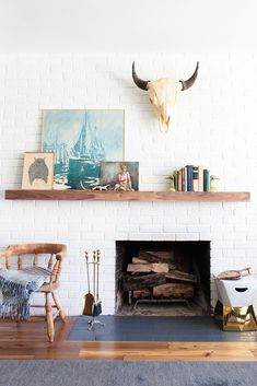 This Weekend Home Makeover Is A Stunner #refinery29  http://www.refinery29.com/budget-living-room-makeover#slide-3  Carson created and installed the custom mantelpiece that same weekend. Here, books and art have space to breathe.