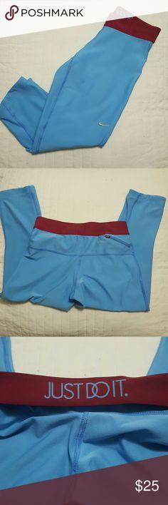 """Nike capri drifit leggings VERY GOOD CONDITION! Size extra small. Baby blue pants with burgundy/maroon elastic waistband. When you flip the waistband over it says """"just do it"""" in baby blue lettering"""" Embroidered gray swoosh. Small pocket w/zipper in the back on the right side.   Length laying flat is 25 inches. Width is about  11.5  inches across.   No trades. Bundle to save on shipping! Nike Pants Leggings"""