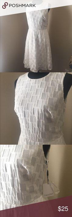NWT Calvin Klein Dress Beautiful white dress from Calvin Klein. New with tags! Calvin Klein Dresses