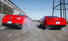 Double Jeopardy: A classic confrontation that never seems to get old.  #cars #auto #Ford #Mustang #GT5.0 #Chevrolet #Camaro #SS #red #fast #comparo #burnout Camaro Vs Mustang, 2011 Ford Mustang, Camaro Ss, Ford Gt, Chevrolet Camaro, Auto Ford, Chevy, Pontiac Gto, Unique Cars