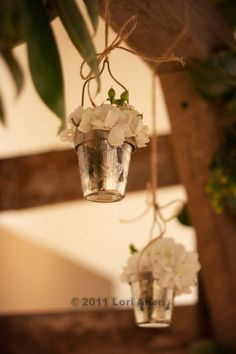 mercury glass pots hanging from wedding arch