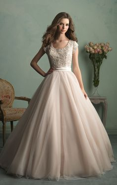 Allure Bridals M524. This elegant wedding gown features scallop neckline and cap sleeves. The bodice embellished with shining beads. The full ballgown skirt crest with a train that exudes elegance as you down the aisle.