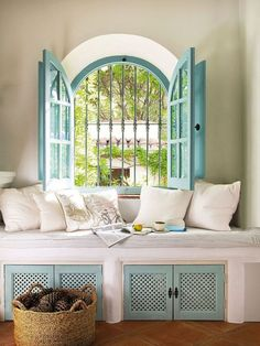 Nice sofa place in front of a window. Provence style living. Holiday house in Spain. Designers: Linda and Martin Bradbury.