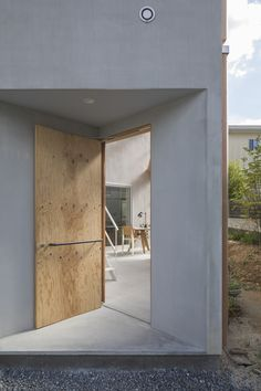 House in Sonobe is a minimal home located in Sonobe, Japan, designed by Tato Architects Wooden Partition Design, Wooden Partitions, Doors And Floors, Windows And Doors, Main Entrance, Entrance Doors, Barn Doors, Wooden Door Hangers, Wooden Doors