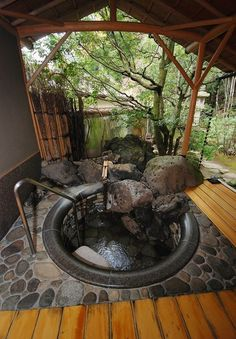 THough it misses the mark for me in many ways, I like the idea of the boulders incorporated into the tub.  CS
