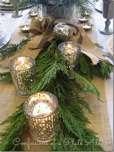 A Country French New Year Mercury glass votive holders twinkle among the cypress branches that serve as a sort of natural table runner. French Country Christmas, Rustic Christmas, Christmas Home, Christmas Holidays, Country French, Christmas Table Settings, Christmas Tablescapes, Christmas Table Decorations, Decoration Table