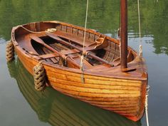 This rowing/sailing dinghy is based on George Cockshott's 1913 design done for the British Boat Racing Association.