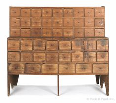 "Pine apothecary cabinet, late 19th c., 54 1/2"" h., 60"" w."