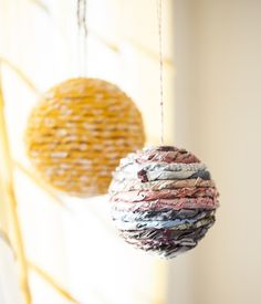 Easy DIY Wrapped Ball Ornaments - wonder how this would look with just book pages?