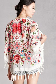 A semi-sheer silk kimono by JayLey™ featuring velvet floral designs, an open front, 3/4 sleeves, and netted tassel trim.