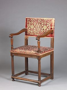 Date: 15th or 16th century (textiles) and 16th century, second half (woodwork) Culture: French and Italian Medium: Walnut, carved and turned; upholstered with various fragments of silk and gilt-metal embroidered fragments, silk, and brocatelle and knotted silk fringe. Dimensions: H. 100.3 cm, W. 56.5 cm, D. 58 cm Back: 42 x 66.8 cm.; Seat: 58 x 70 cm.; Fragments: b) 33 x 9.5 cm.; c) 49 x 5.5 cm.; d) 33 x 5 cm.