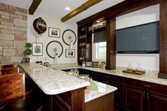 The contrast between the white granite and dark wood is stunning. HBWB | MiraBay | Florida | Newland