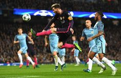 Lionel Messi of Barcelona (C) volleys during the UEFA Champions League Group C match between Manchester City FC and FC Barcelona at Etihad Stadium on November 1, 2016 in Manchester, England.
