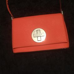 orange kate spade purse only been used a few times, in great condition, adds an awesome pop of color to any outfit, perfect size, does have some scratches on the gold emblem but hard to notice from far away kate spade Bags