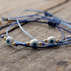 Now available with white evil eye bead
