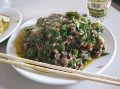 Stir-fried beef with pickles and garlic chives