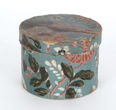 """Wallpaper box, mid 19th c., with floral decoration on a light blue ground, 3 3/4"""" h., 4 3/4"""" w."""